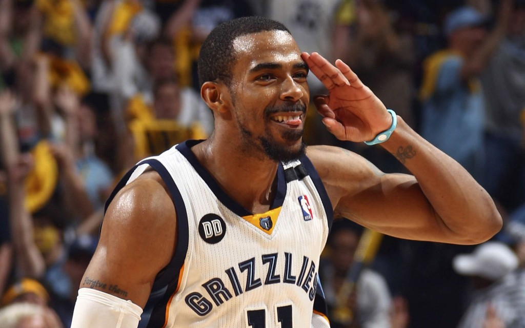 Memphis Grizzlie Mike Conley celebrates a three-point basket against the Los Angeles Clippers during NBA basketball action in Memphis