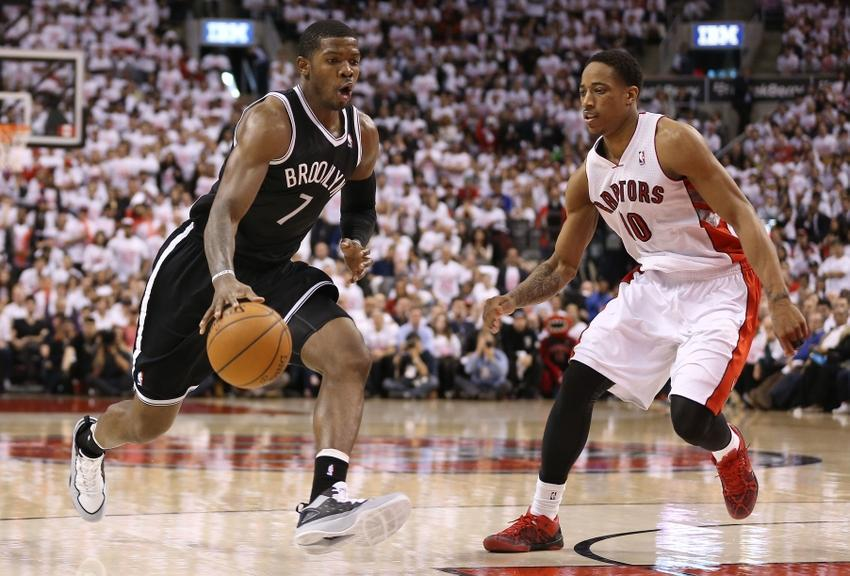Joe Johnson attacks the basket. Demar Derozan pretends to care.